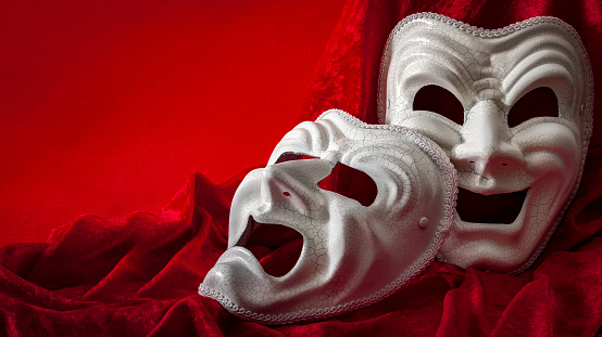 istock Theatre and opera concept with theatrical masks on red velvet 859332932