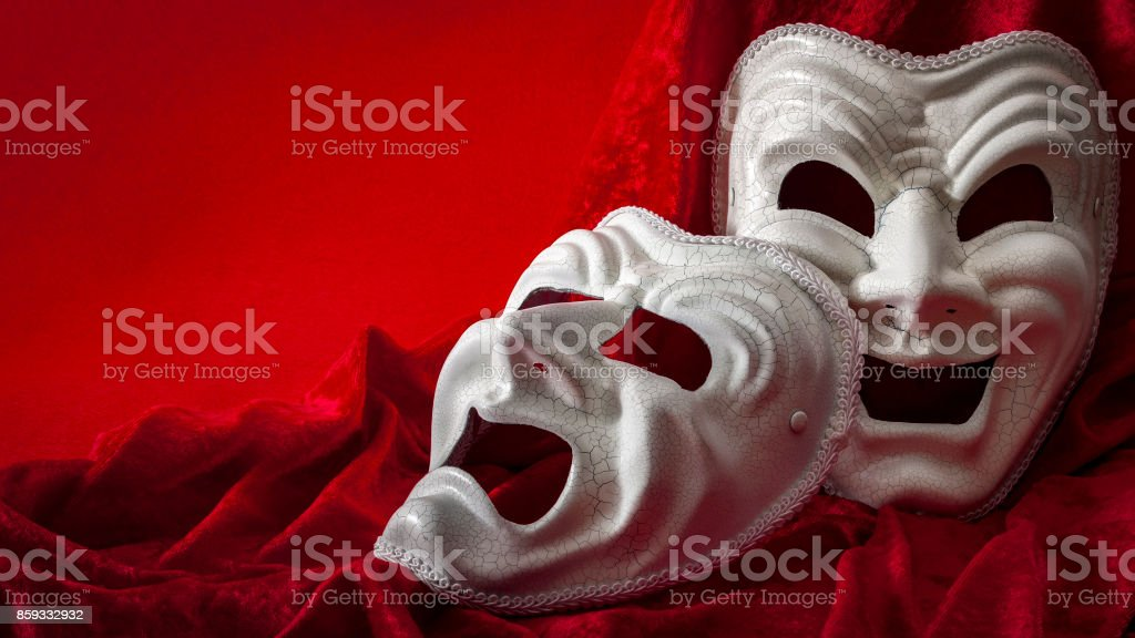 Theatre and opera concept with theatrical masks on red velvet stock photo
