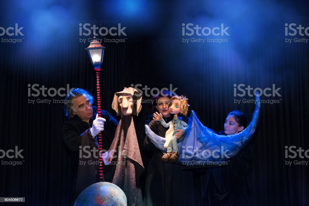 Theatre artists with their puppets plays a drama stock photo