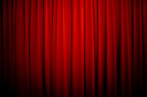 Royalty free stock photo of a theatre curtain background with vignette.
