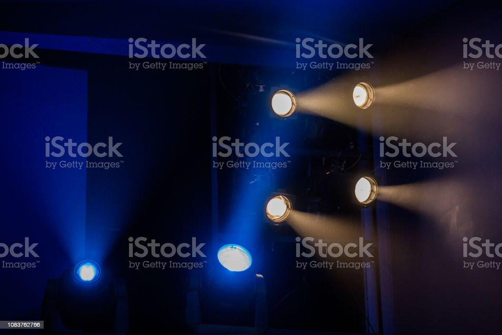 Theatre lighting equipment. The light rays from the spotlight through...