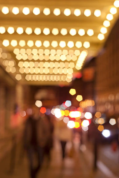 Theatre Marquee Theatre marquee at night with people blurred theater marquee commercial sign stock pictures, royalty-free photos & images