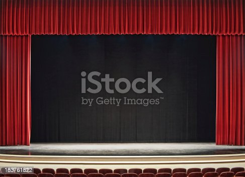 theatre stage with red curtains open