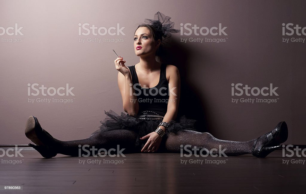 Theatrical girl relaxing, smoking a cigarette. royalty-free stock photo