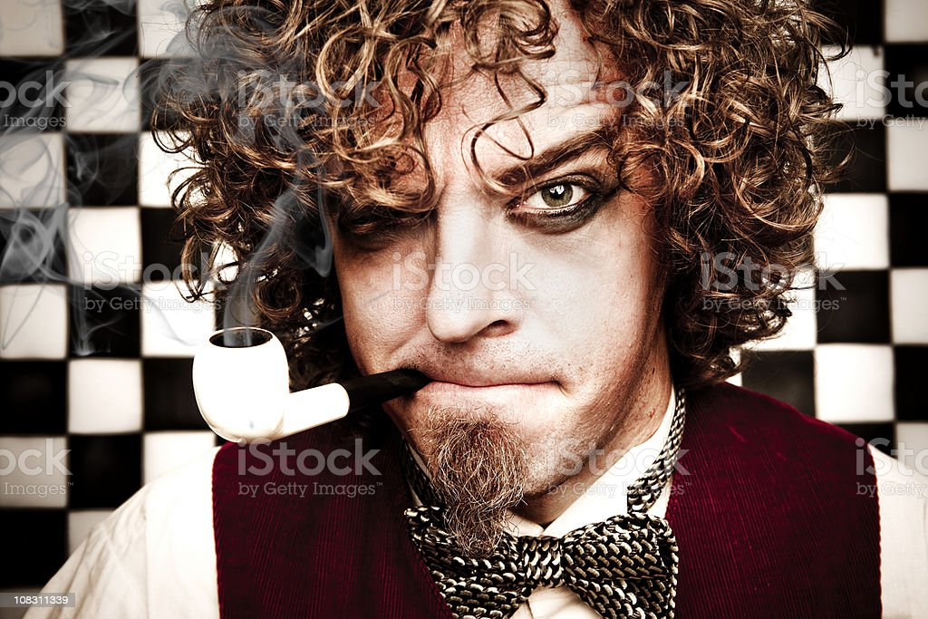 Theatrical portrait of man smoking a pipe royalty-free stock photo