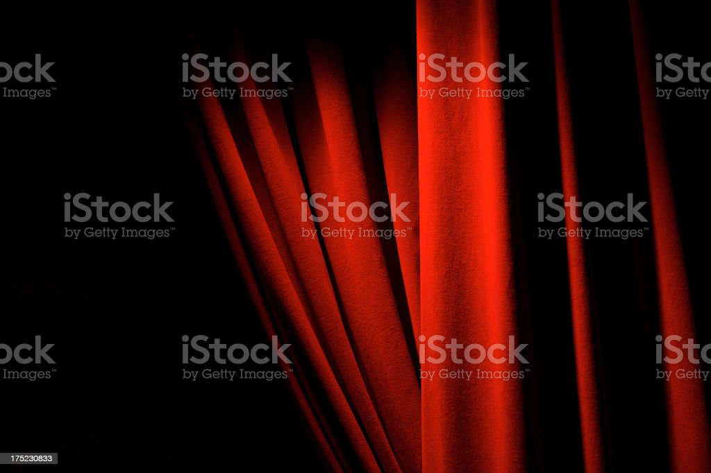 Theatrical Red Velvet Curtains Dramatic Lighting Copy Space stock photo