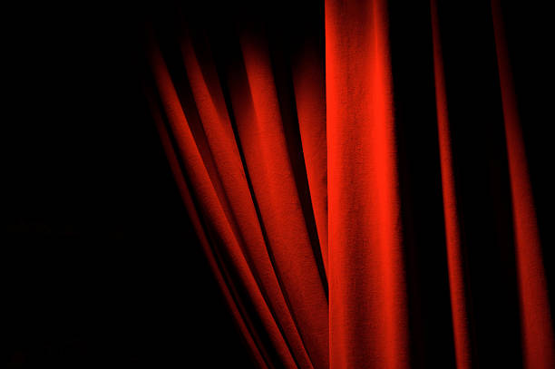 theatrical red velvet curtains dramatic lighting copy space - curtain stock photos and pictures