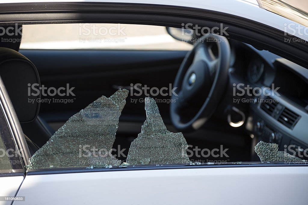 Theft from car with smashed window stock photo
