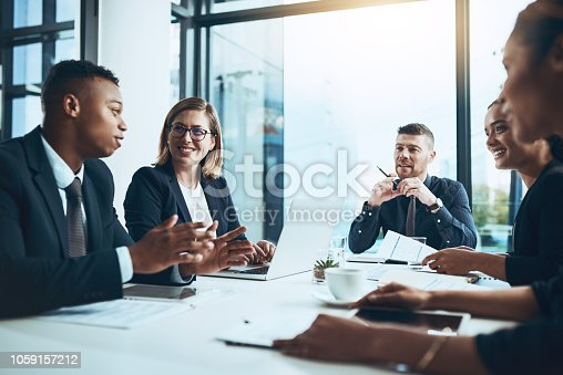 Shot of a group of businesspeople having a meeting in a boardroom
