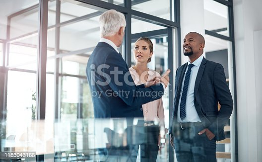 Shot of a group of businesspeople having a discussion in a modern office