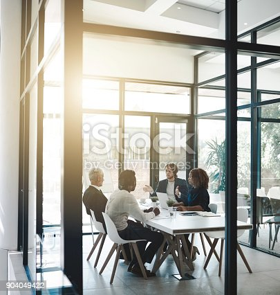 Shot of a group of businesspeople having a boardroom meeting in an office