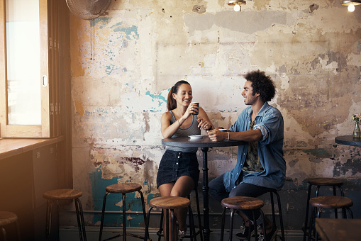 Shot of a young couple having a coffee date at a cafehttp://195.154.178.81/DATA/i_collage/pu/shoots/806208.jpg