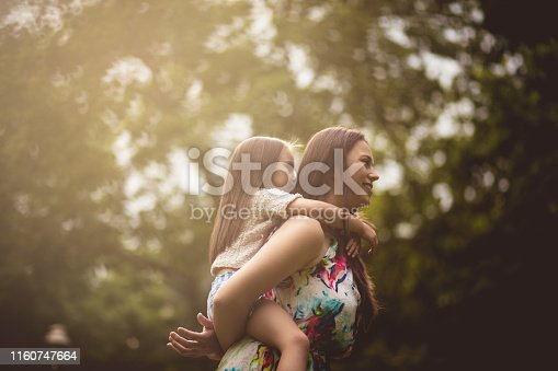 Their love knows no limit. Mother and daughter in nature.