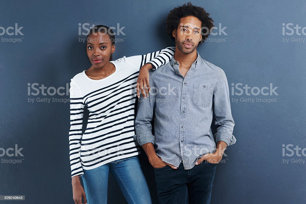 Their relationship is getting serious Portrait of a beautiful young couple on a gray background Adult Stock Photo