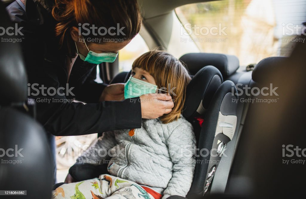 Their safety depends on you Shot of a toddler boy being secured in his car seat by his mother 30-39 Years Stock Photo