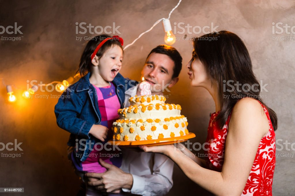 Theme Family Holiday Childrens Birthday And Blowing Out Candles On Large Cake Young Of
