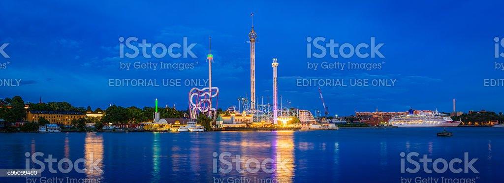 Theme park fairground rides illuminated Tivoli Grona Lund Stockholm Sweden stock photo
