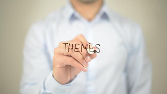 Themes, man writing on transparent screen