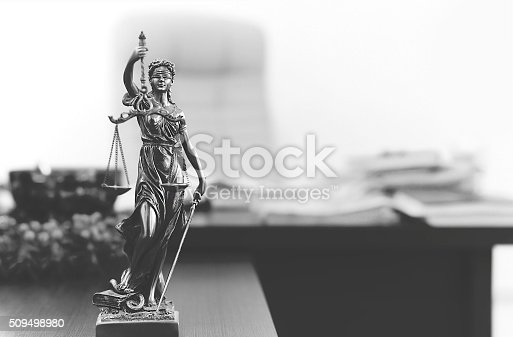 istock Themis statue in lawyer's office 509498980