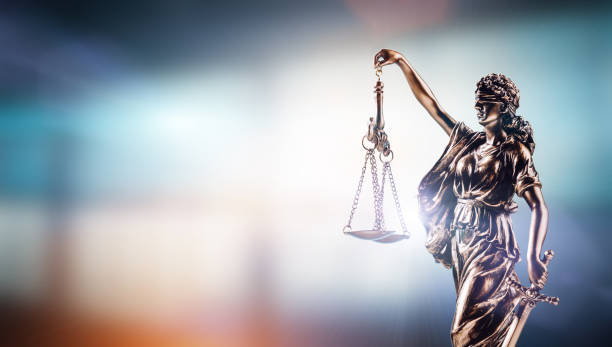 Themis, symbol of law on modern background. stock photo