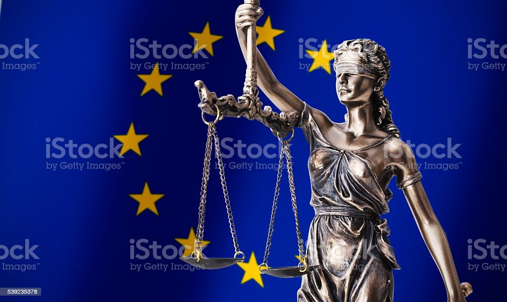 Themis with scale, symbol of justice on European Union flag royalty-free stock photo