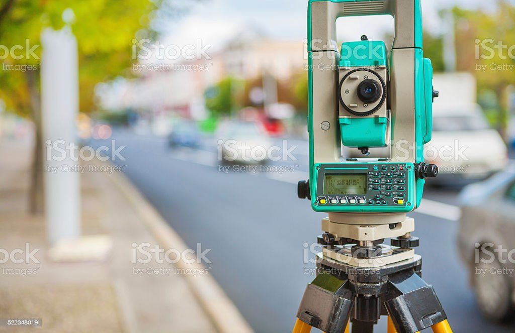 theodolite on streen of small town stock photo
