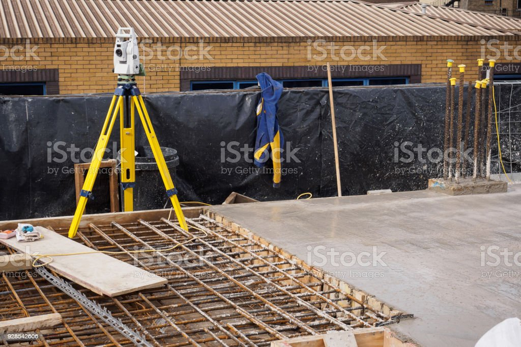A Theodolite On Use On A Partially Cast Concrete Slab In A