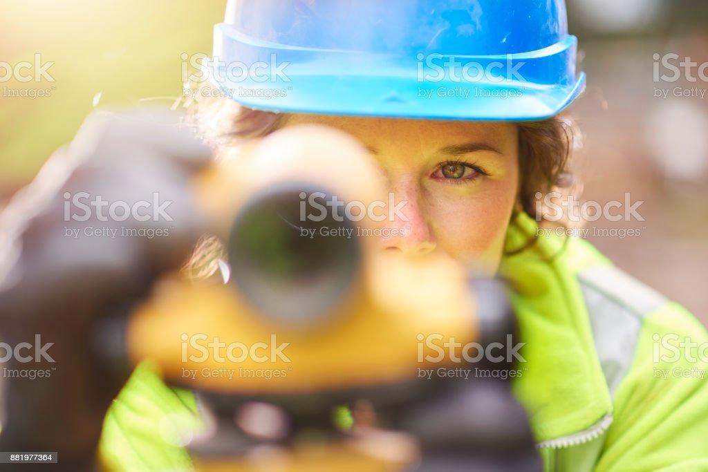 theodolite worker stock photo