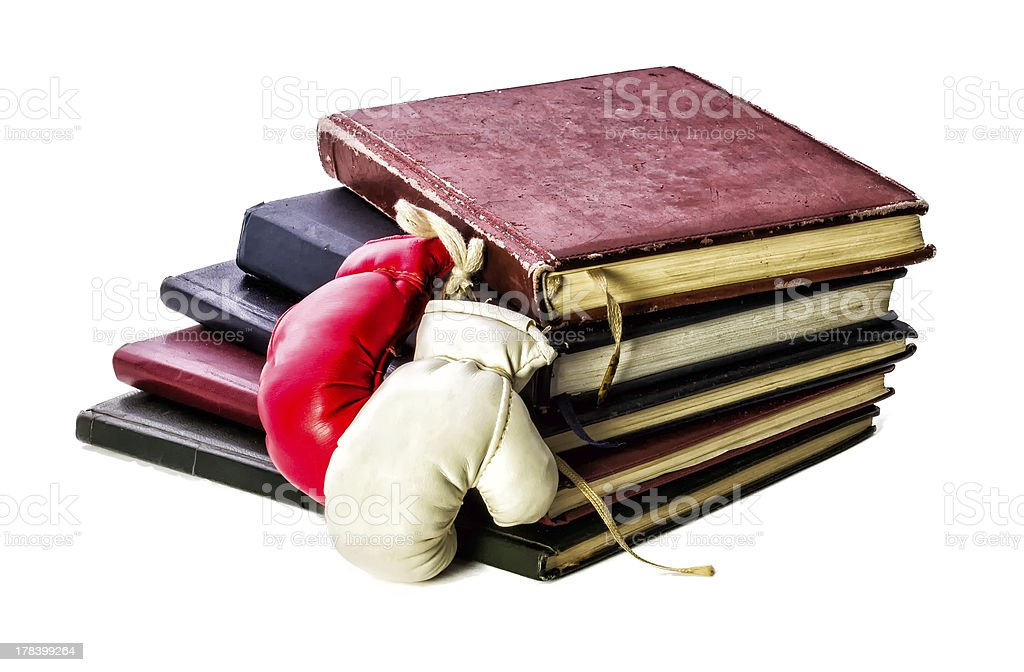 Theory and Practice! Books with Boxing Gloves stock photo