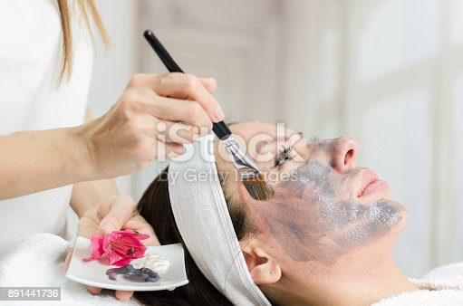 istock Therapeutic black mask on female face 891441736