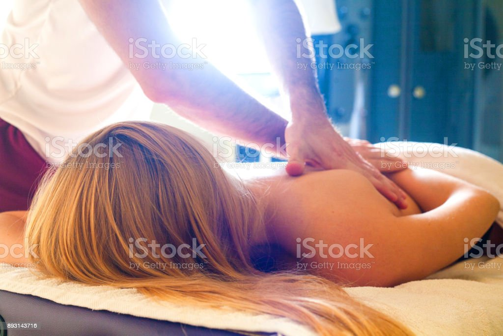 therapeutic massage manual therapy for curing pain in the joints of the osteochondrosis stock photo