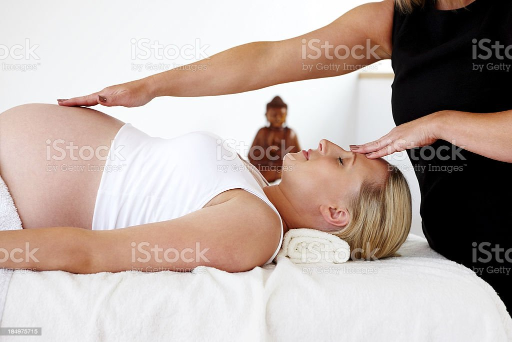 Therapeutic massage on pregnant woman at wellness center royalty-free stock photo