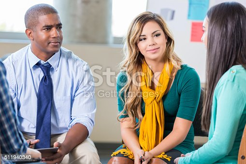 istock Therapist and teens in support group 511940340