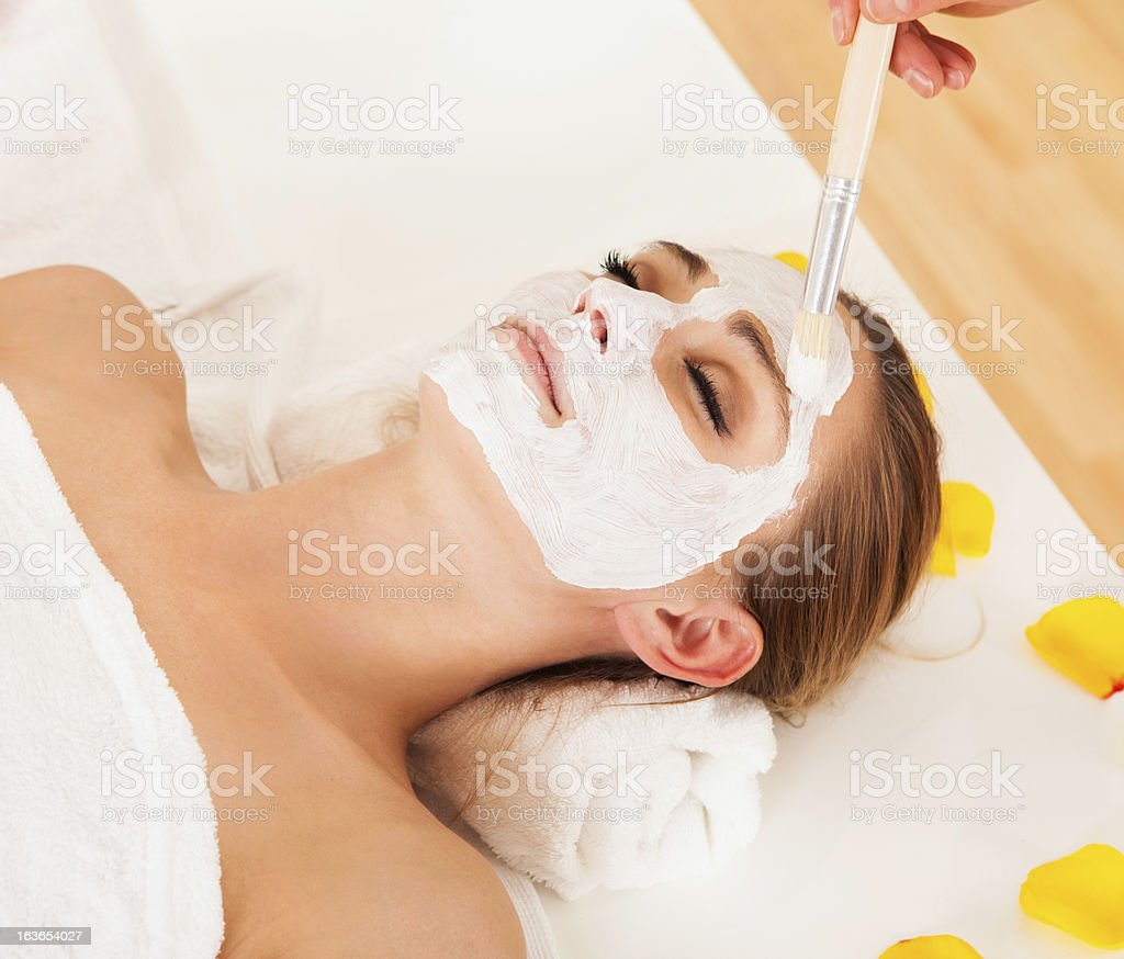 Therapist applying a face mask royalty-free stock photo