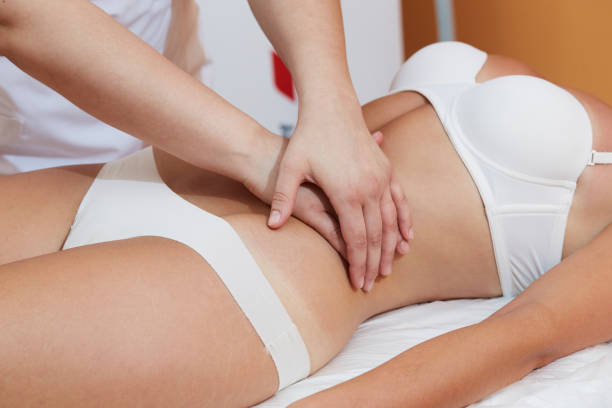 therapist - belly massage at spa salon stock photo
