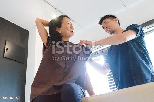 522625266 istock photo Therapist examining a patient 810757162