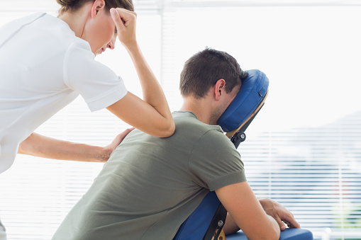 istock Therapist giving back massage to man 843241520