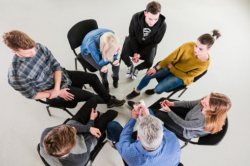 Therapist Giving Solution To University Students Stock Photo - Download Image Now