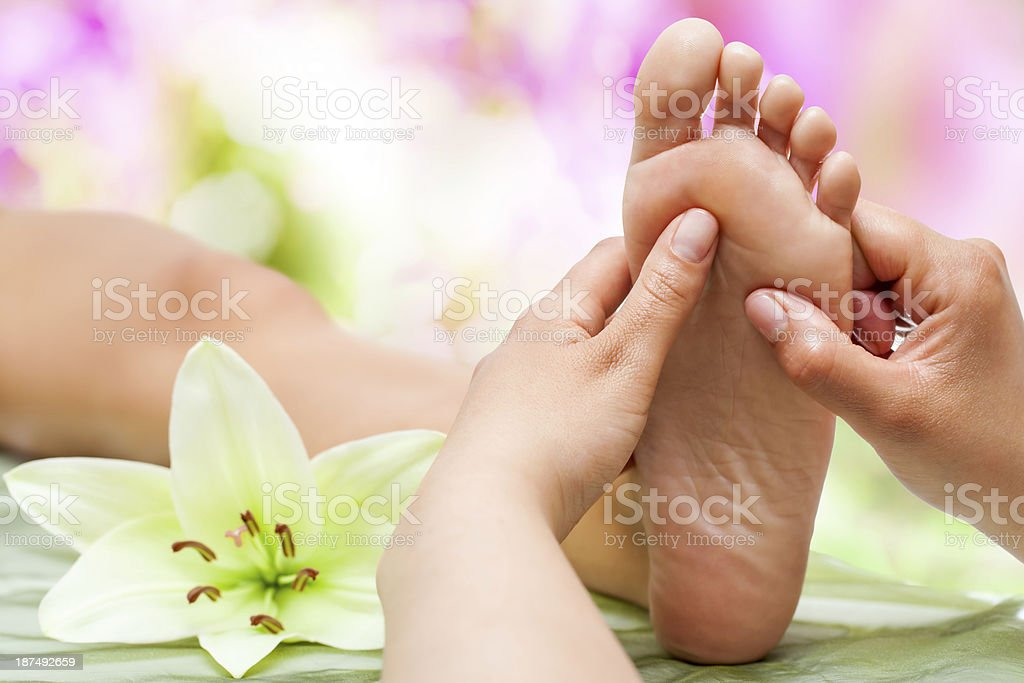 Therapist hands massaging foot. royalty-free stock photo