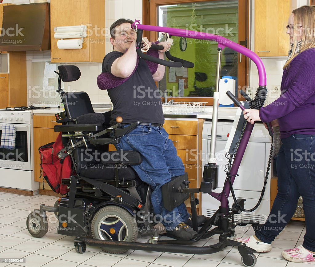 Therapist helping a young cerebral palsy patient. stock photo