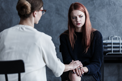 Therapist Looking After Her Patient Stock Photo - Download Image Now