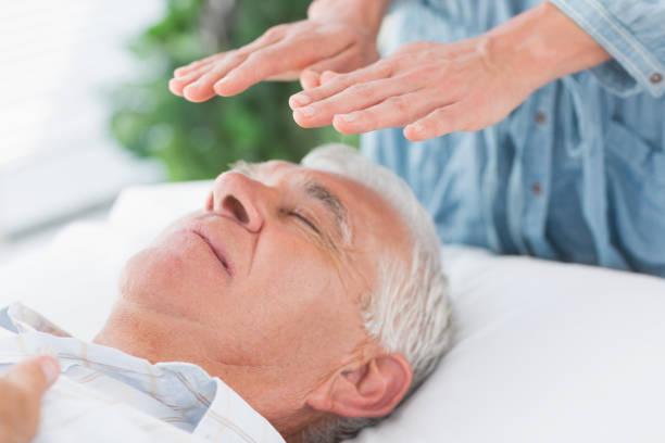 Therapist performing reiki over senior man picture id843206486?b=1&k=6&m=843206486&s=612x612&w=0&h=4uq irxjqftq6sv4gjnfxmdq qo7tunsuvndnfuxykk=