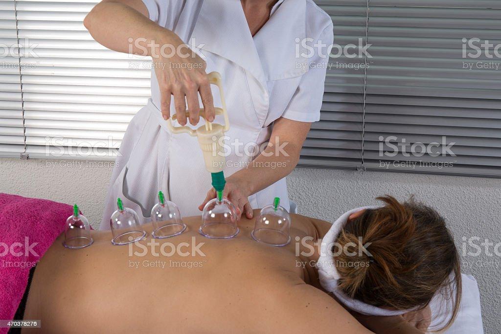 Therapist removing a glass globe stock photo