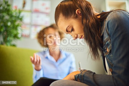 istock therapist session with young woman 540592232