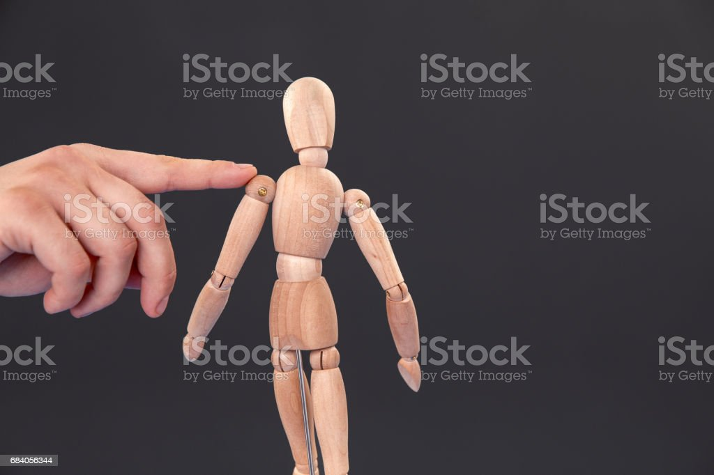 Therapist Showing The Right Posture On The Wooden Mannequin stock photo