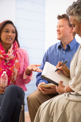 Therapist Takes Notes In Counseling Session Man Woman ...