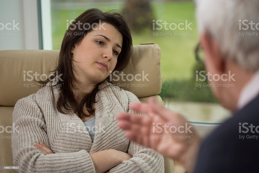 Therapist talk to his patient stock photo