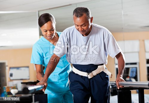 istock Therapist with patient doing gait training 184976955
