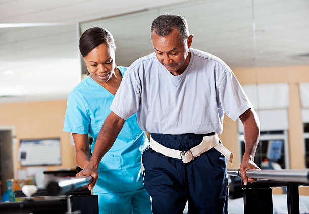 Therapist with patient doing gait training stock photo