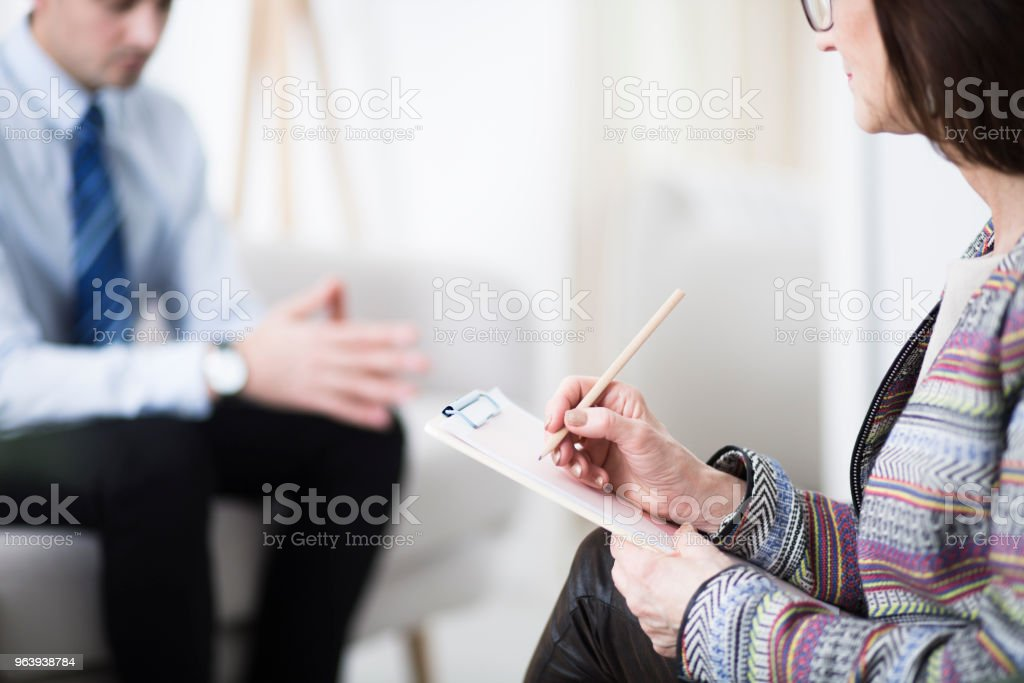 Therapist writing notes - Royalty-free Adult Stock Photo